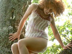 Tree Climbing Redhead Masturbates In The Forest